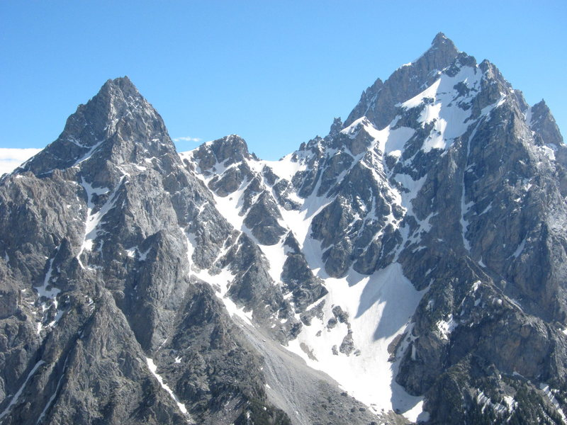 Teewinot, Owen, and the Grand Teton as seen from high on Symmetry Spire. (Mount Owen is directly in front of the Grand in this photo.)