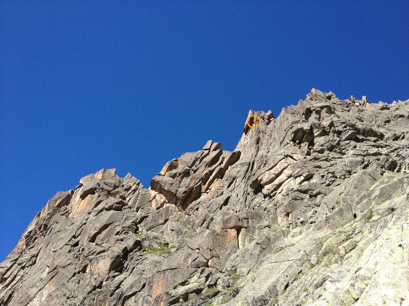 Climber (orange circle) on the crux of the route in 3rd tower, as seen from the descent.
