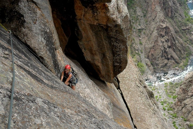 Brenda starts the short layback, below the undercling on pitch 4.  This was one of the better pitches on the climb.