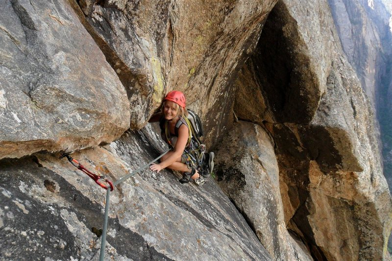 Brenda rests on a good foot hold near the end of the undercling section.