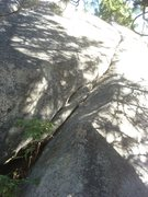 Rock Climbing Photo: Golden Grits starts at a shady ramp, and ends at a...