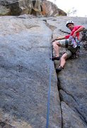 Rock Climbing Photo: Climber getting pro before launching into the crux