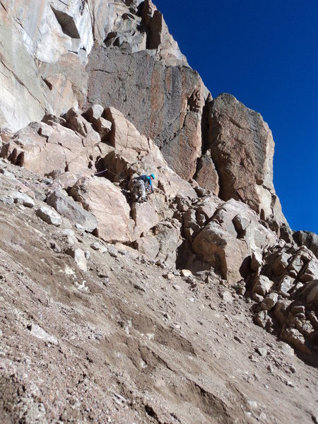 Joe starting P1 of the route (left start) after crossing scree on hard snow.  Do not go too high here.  You aim for below the lowest notch on the skyline.
