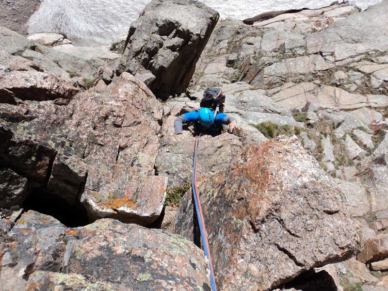 Joe approaches the belay ledge for P2.  This pitch's crux is likely at the start of the pitch.