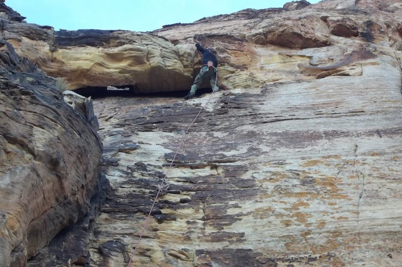 Gettin into the roof on prophecy wall 10c. Near St.George utah, November 2011.