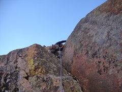 Rock Climbing Photo: Leo heads up pitch 5.