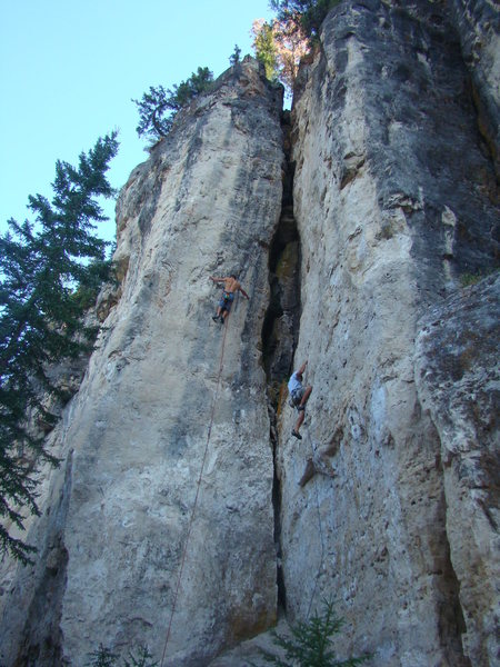 Climbers taking on Shady Lady (left) and Starfighter (right). These two pleasing lines clock in at 5.12c.