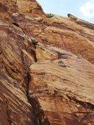 Rock Climbing Photo: Riding the sandstone wave on Wishbone.  Photo: Lar...