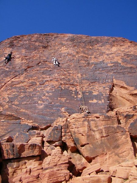 Climbers on Neon Sunset (center) and Electric Koolaid (right).