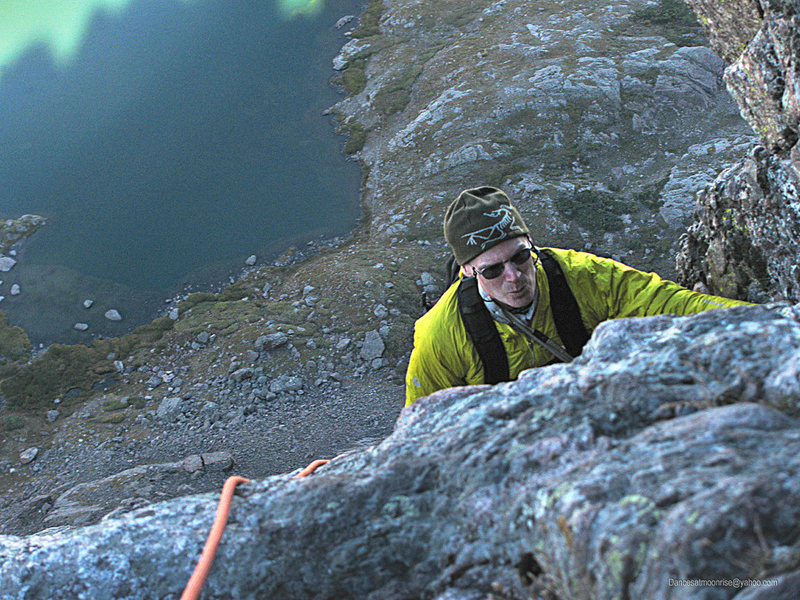 Topping out on the crux pitch.