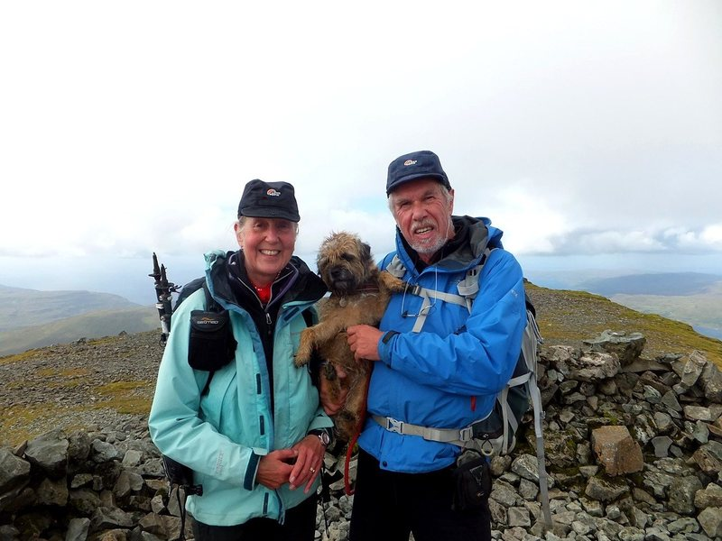 Lyn and Pete Armstrong on the summit of their final 282 Munro.Ben More ,Isle of Mull .Plus of course Bella the Border Terrier