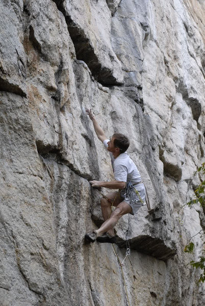 Rock Climbing Photo: Rich Romano doing the low crux reach from the slot...