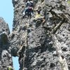 Mark Canavan (leading) and Shaun Coe on pitch 2 of Dragons Spine. Most of this pitch is sweet, fun and easy. <br> <br> The Old Witch Pinnacle is partially visible on the left.