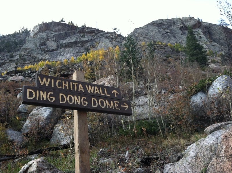 The upper sign with Wichita Wall and Ding Dong Dome in the background.