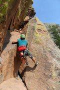 Rock Climbing Photo: Iris lays back the bulge start on pitch 3.