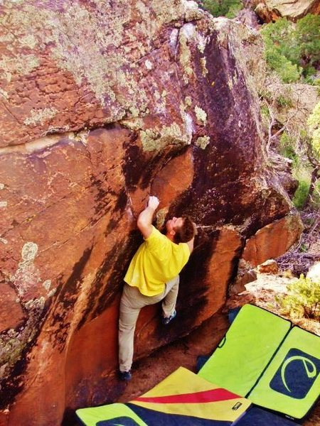 Starting out the Duskian Suit problem on the Equinox Boulder.