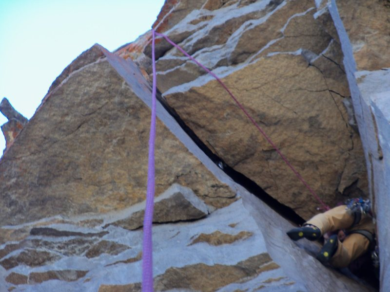 Rock Climbing Photo: Roy cleaning gear under the roof and hoping for no...