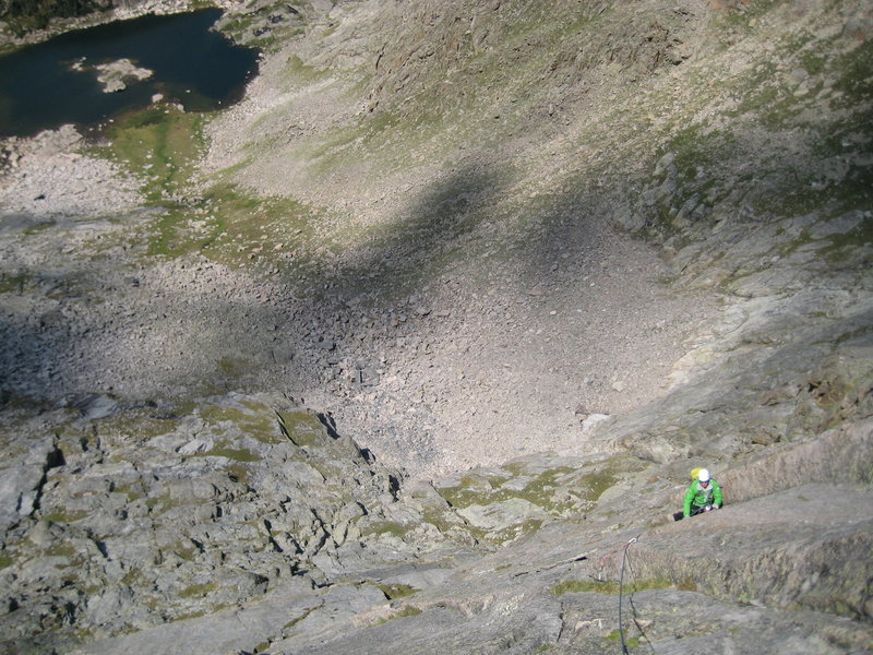 Luke eyeing the traverse on P2.