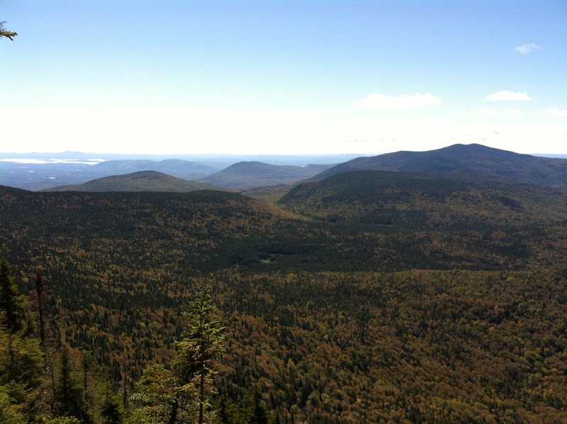 Looking south from South Tripyramid toward Sandwich Notch. Squam Lake can be seen in the distance.