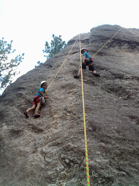 My boys climbing at Rushmore.