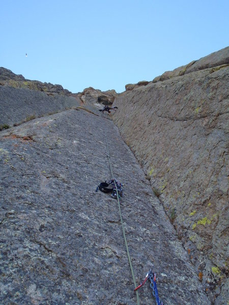 Near the top on Soaring, September 2010.  It's classic stemming all the way. Anchors just below the roof. The guidebooks suggested I might need gear, but a little way up I could see that it was bolted all the way, so I dumped the rack on a bolt. Photo: Kristin Felix
