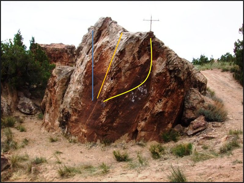 Desert Storm Boulder.  I Spade My Cat (V1+) in blue, Wise Water (V2) in orange, and Overland Flow (V0+) in yellow.