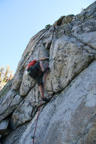 Rock Climbing Photo: The start of the crux sequence - a high step into ...