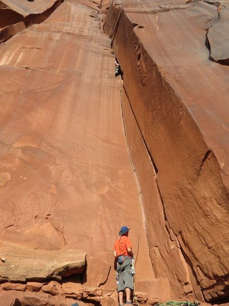 """A much better beta shot. Note the twin crack start...one (thin) making the left corner and the fat hand crack along the right wall. Also see the obvious micro ledge, right crack, 20 feet off the deck. THIS is the Bloom un-named 5.10+ around the corner from """"Where's Carruthers?."""""""