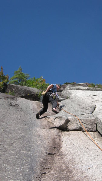 Brad White leads the second pitch flake<br> of Old Route. Photo by Matt Peer