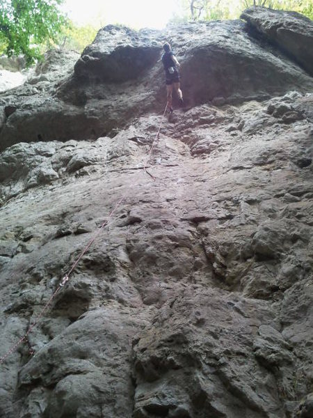 Rock Climbing Photo: A climber working through the overhang, not yet to...