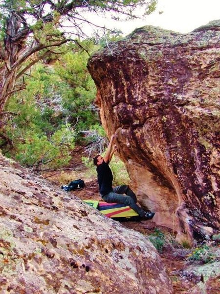 Barrow Boulder's east-facing overhang.  Arien missing the tough move to the crimp on the Barrow Wight problem.