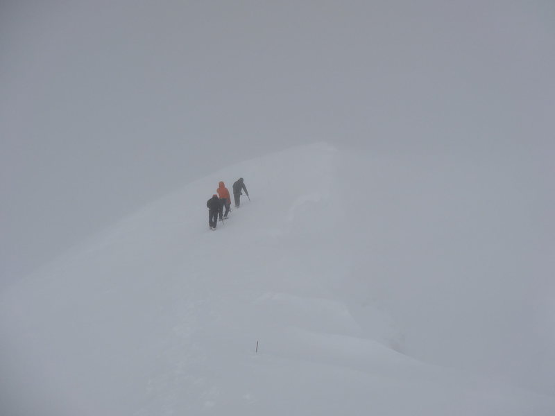 Shad, Eric, and Daniel on the summit ridge. Not much to see.
