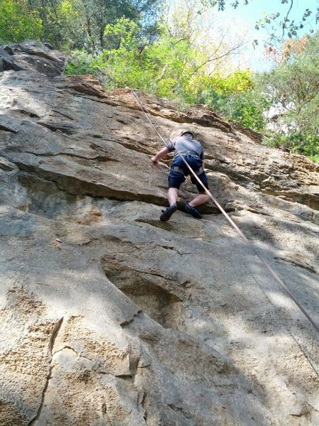 a beginner climber sends Independence Day on a warm fall day in October 2012.
