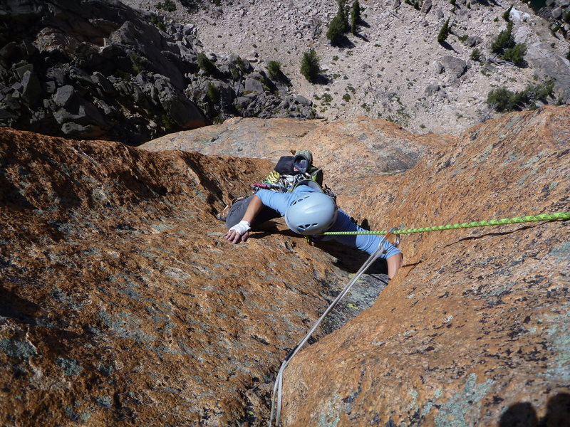 Jenny on the amazing dihedral to finish the pitch that I described where many people get off route. belay is hand pieces.<br> <br> You will be right on the nose of the formation at this belay.