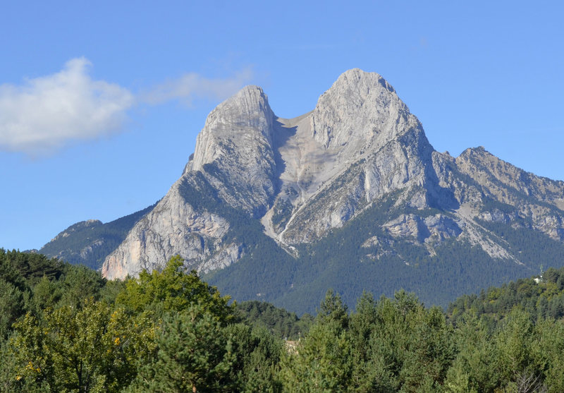 The east face of Pedraforca. The Refugi is located at lower right of the mountain@SEMICOLON@ the south face is barely visible at the top of the Pollego Inferior (left peak).