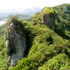 The Ray of Light Spire, back side of Adam's Apple, Sokehs Ridge and Pohnpei Island, as seen from the top of Sokehs Rock.