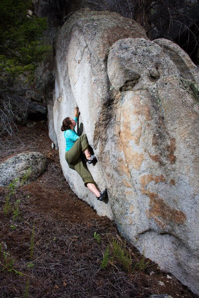 Hailey climbing some boulders at the base.