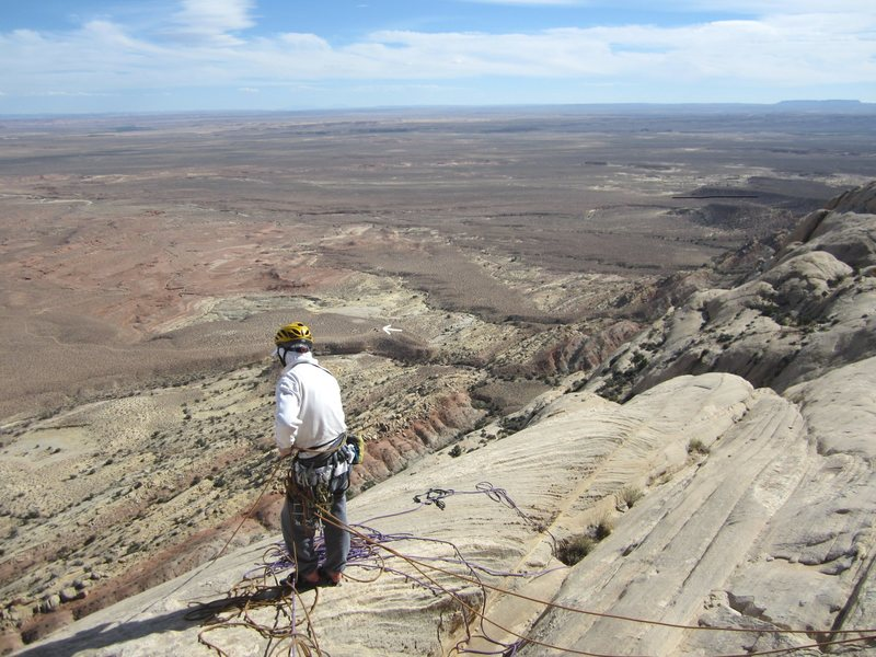 Belay on summit .note white arrow showing trucks at camp.