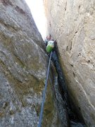 Rock Climbing Photo: The flared squeeze crux at the start of pitch 2.