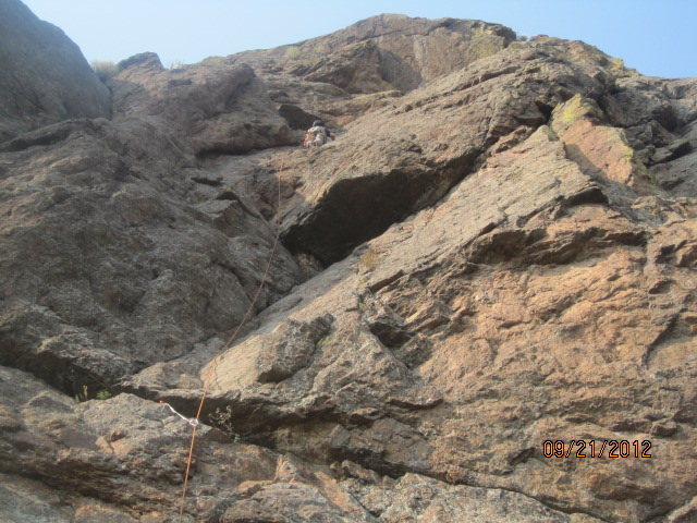 D 3/4 up P1.  Variations abound as solid routes litter this formation.  Check a local guidebook for authoritative beta.