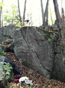 Rock Climbing Photo: Emily cleaning the Creekside Boulder