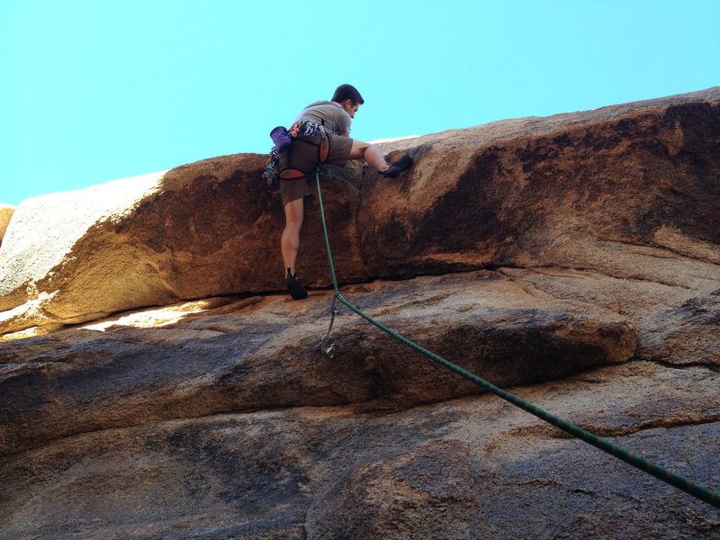 Rock Climbing Photo: Making the move over the roof. Get that cam in the...