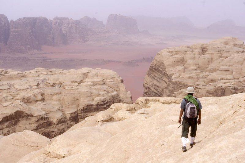 Sabbah traversing white sandstone domes enroute to the summit of Jebel Khazali during as ascent of Sabbah's Route (III, 5.6), Wadi Rum, Jordan, March 2012