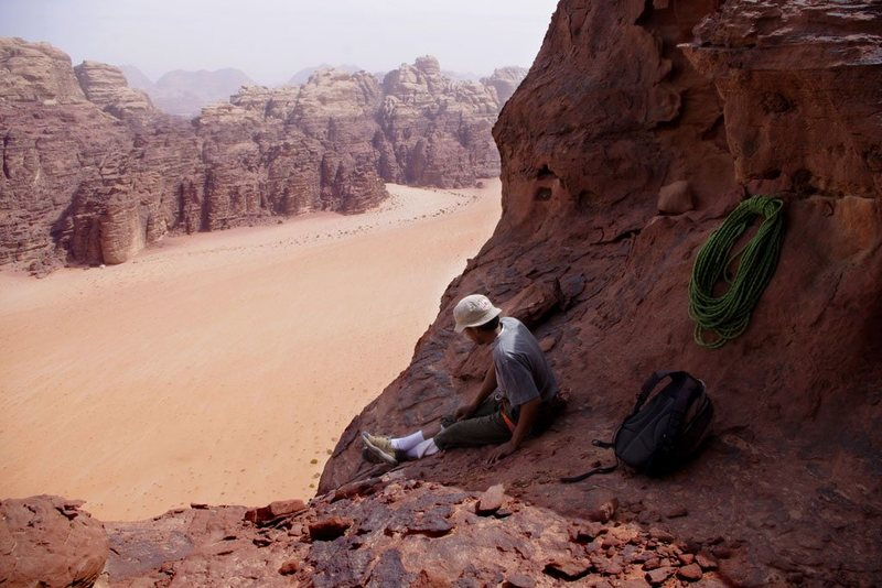 Down-climbing and rapping off Jebel Khazali after an ascent of Sabbah's Route (III, 5.6). It was 95 degrees. Wadi Rum, Jordan, March 2012