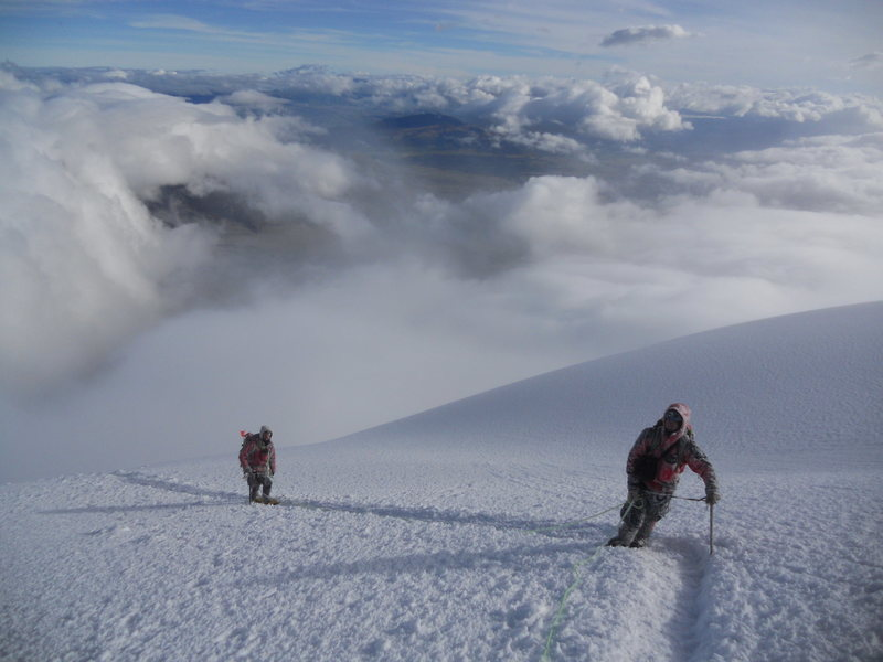 Climbing out of the clouds and into the sun on Cotopaxi
