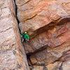 Paul Donnithorne on Honker 5.10b, Upper West Walls, Tifghelt Col, Tizi Escarpment, Morocco, photo Emma Alsford