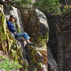 Landy at the belay tree, (10 ft rotten rock is all below him, beware).