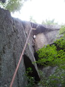 Rock Climbing Photo: James Debella cleaning the new route at the overha...