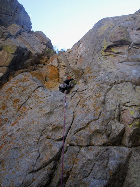 Kat A. gets started on the trad portion of 'Saved By the Bell' (11a) on Bell Buttress in Sept. 2012.