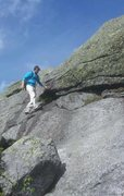 Traversing a slab of adirondack granite on a windy descent of Colden.